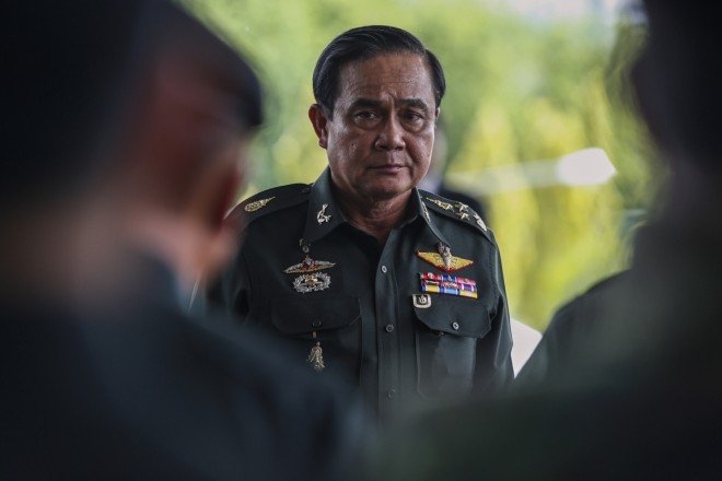 Thai army bans 155 prominent figures from leaving country