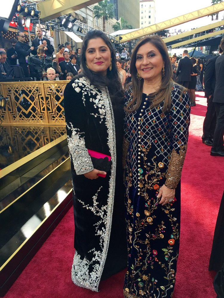 Sharmeen with her mother at Oscar ceremony before taking her second Oscar award. Wearing a traditional black gown, she came to receive her award in an impressive way of an eastern woman. Her gown had a traditional silver embroidery work that is very popular in South Asia and Central Asia.